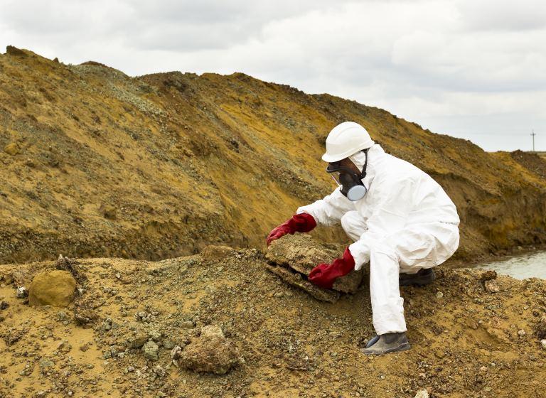 technician testing hazardous waste