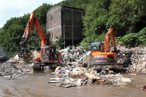 heavy machinery sorting waste for recycling
