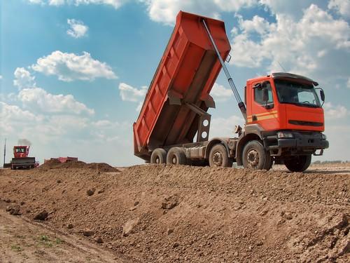 Tipper truck dumping aggregate